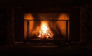 Metal Fireplace Screen in front of roaring fire