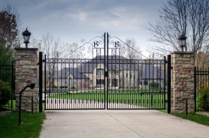 Large home behind an ornate iron entry gate