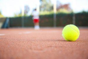 Tennis ball on the floor of a tennis court