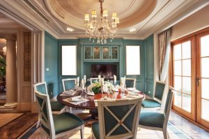 Luxurious dining room with chandelier lighting over table