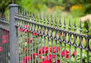 Ornamental fence in front of rose garden