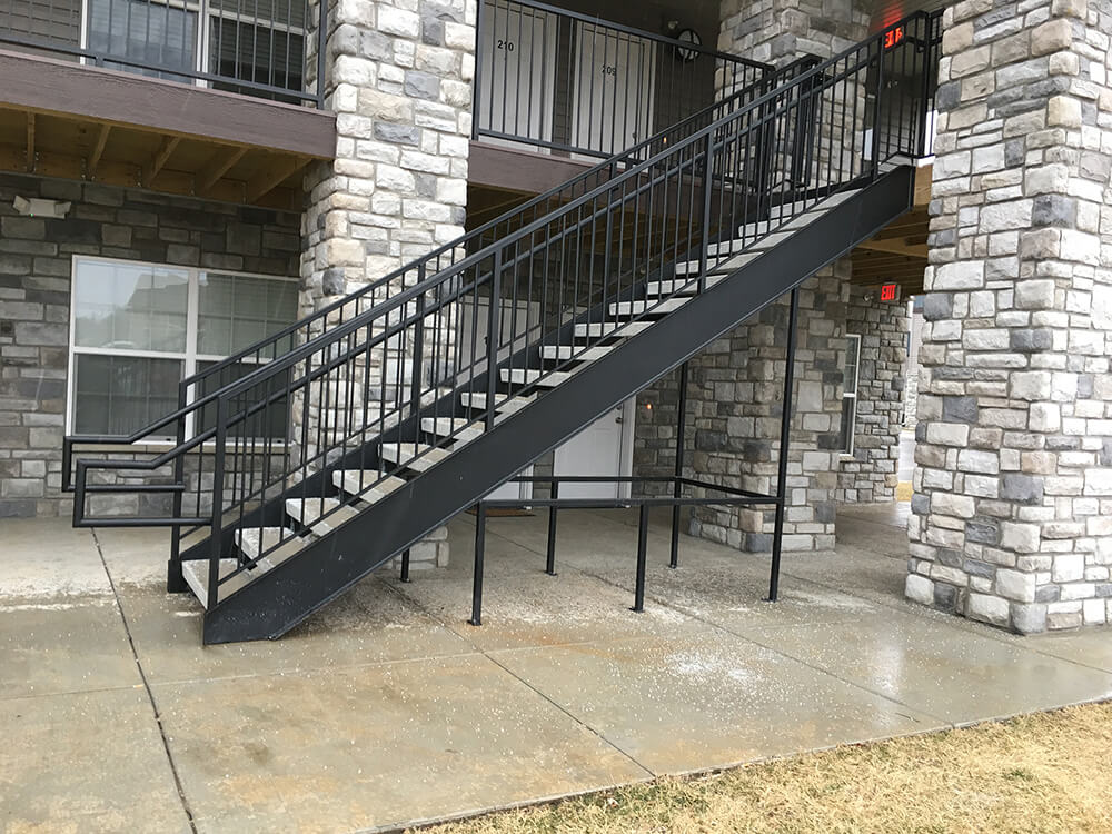 Single run exterior stair with railings 1 Carnahan-White Fence Company