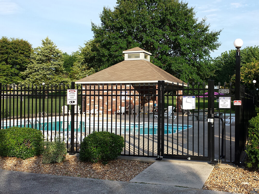 black alumiguard around pool Carnahan-White Fence Company
