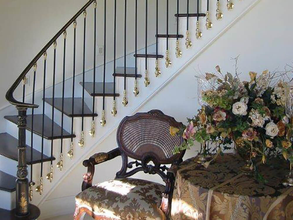 stair railing with gold accents Carnahan-White Fence Company