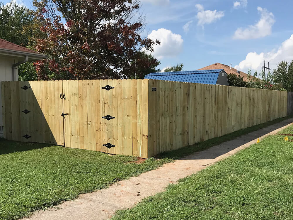 woodfence-with-shed Carnahan-White Fence Company