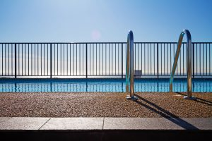 Black fence surrounding a pool