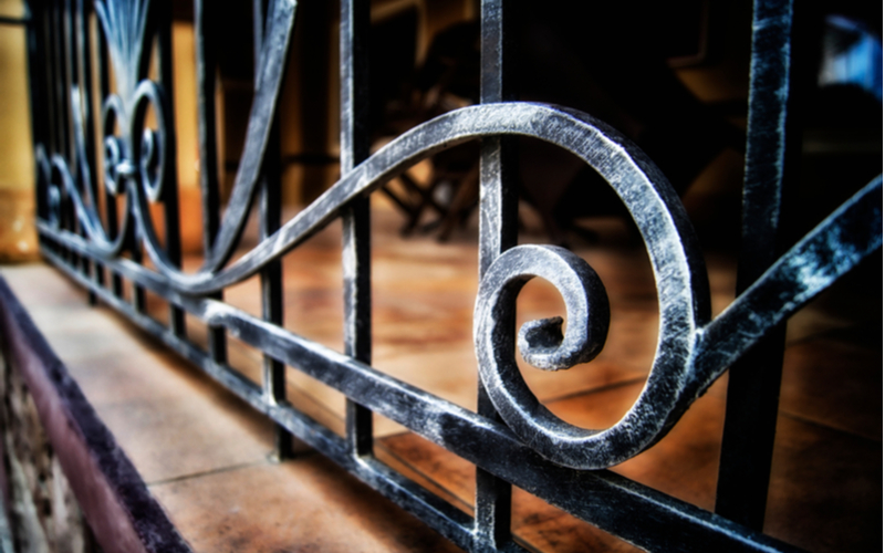 Closeup picture of an iron ornamental fence