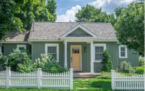 Cottage home with a welcoming white picket fence in the front yard