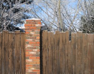 Privacy fence in winter with snow