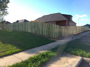 Privacy fence on sloped terrain
